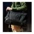 Topo Designs Commuter Briefcase Ballistic/Black Leather on shoulder