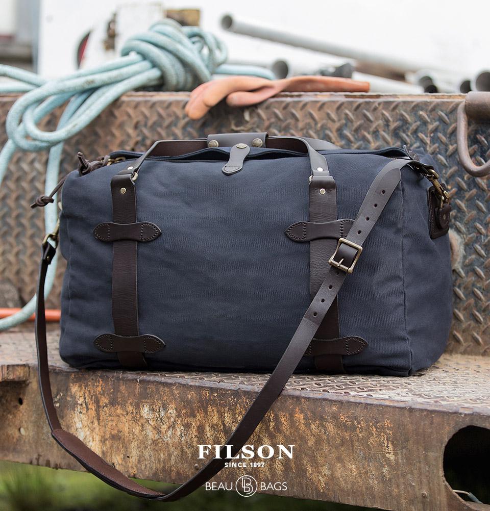 Filson Duffle Medium Navy, reisetasche hergestellt für Schwersteinsätze