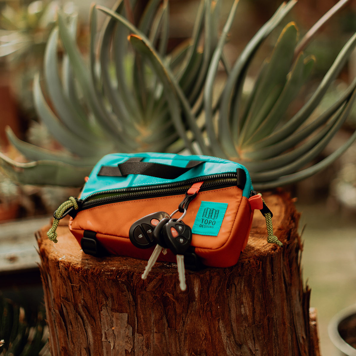 Topo Designs Mini Quick Pack Turquoise/Clay, a well-built, secure bag for travel