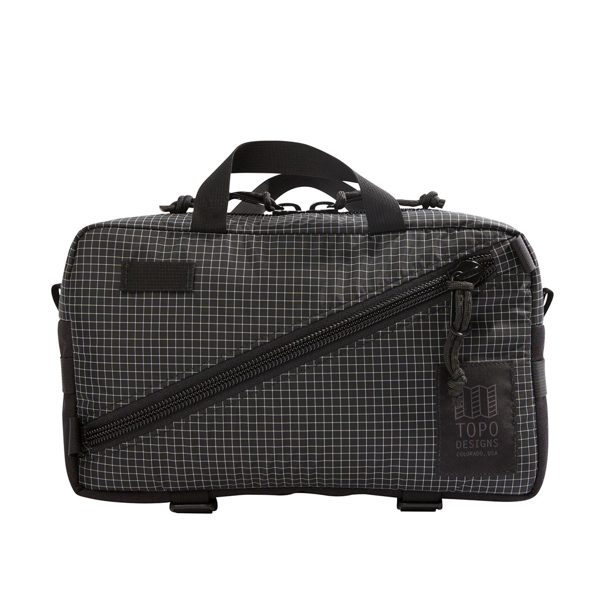 Topo Designs Quick Pack Black/White Ripstop, a well-built, secure bag for travel